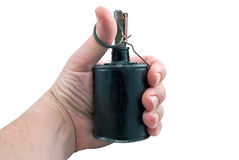 Man holding a hand grenade in his hand Royalty Free Stock Images
