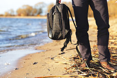 Man holding  in the hand his backpack Stock Image