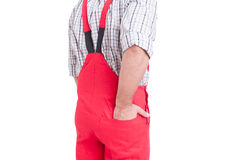 Man holding hand inside back pocket of rompers or coveralls Stock Photos