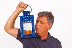 Man holding a hand lantern Stock Photography