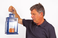 Man holding a hand lantern Royalty Free Stock Image