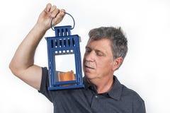 Man holding a hand lantern Stock Photo