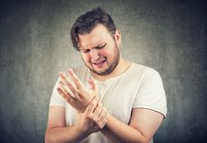 Man holding hand with strain in wrist royalty free stock photography