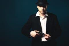 Man holding a handgun. Photo of man shot with studio lighting, holding a handgun Stock Photos