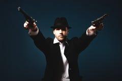 Man holding a handgun. Photo of man shot with studio lighting, holding a handgun Royalty Free Stock Image