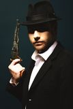 Man holding a handgun. Photo of man shot with studio lighting, holding a handgun Royalty Free Stock Photos