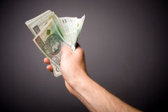 The man holding the hands of banknotes. Royalty Free Stock Photos