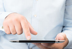 Man holding in a hands digital tablet pc. Stock Photos