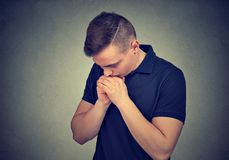 Young man praying in silence stock images