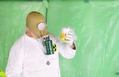 Man holding hazardous chemical Stock Image