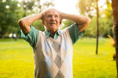 Man holding head in despair. Stock Image