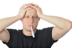 Man holding head in headache with thermometer in mouth Stock Photos