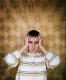 Man holding head in Pain. A young man at which hurts head Royalty Free Stock Photo