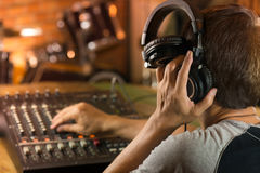 Man holding headphone and  listening to live sound . Royalty Free Stock Photo