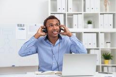 Man holding headphones Stock Images