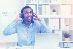 Man holding headphones, toned Stock Image