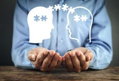 Man holding heads with puzzle pieces. Problem solving concept royalty free stock photography