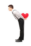 Man holding a heart and giving kisses Royalty Free Stock Photos
