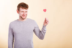 Man holding heart in hand. Stock Images