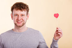 Man holding heart in hand. Stock Photos