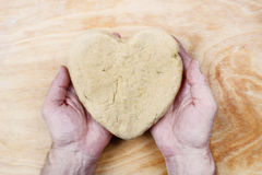 Man holding heart made of pastry stock photos