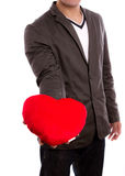 Man holding heart shape pillow. Stock Image