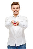 Man holding heart shaped gift Stock Photos