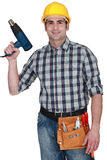 Man holding heat torch Stock Photo
