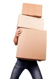 Man holding heavy card boxes. Isolated on white Stock Image