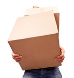 Man holding heavy card boxes. Isolated on white Royalty Free Stock Images