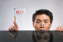 Man holding help flag Stock Images