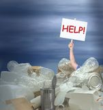 Man holding Help! sign in giant pile of recyclable containers products representing environmental challenges Stock Photos
