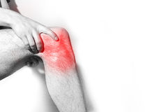 Man, holding her painful  Knee,  leg, experiencing pain,  red sp Royalty Free Stock Images