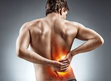 Man holding his back. Kidneys pain. stock images