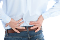 Man Holding his Back While Suffering From Back Pain. Isolated on a White Background Stock Photos