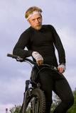 Man holding his bicycle Royalty Free Stock Photos
