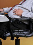 Man holding his bloated stomach Stock Photo