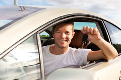 Man is holding his car key sitting inside Royalty Free Stock Image