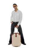 Man holding his carry-on. Business holding his carry-on luggage royalty free stock images