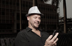 Man holding his cellphone Stock Photography