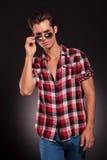 Man holding his fashionable sunglasses Royalty Free Stock Photos
