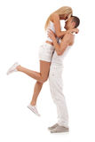 Man holding his girlfriend in the air Royalty Free Stock Images