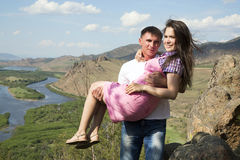 Man holding his girlfriend in his arms Stock Photography