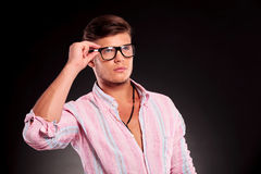 Man holding his glasses Stock Photography