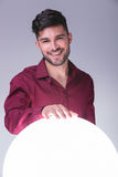 Man holding his hand on a big sphere of light Royalty Free Stock Photos