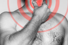 Man holding his hand on his throat, acute pain. Monochrome image, on a white background. Pain area of red color royalty free stock images