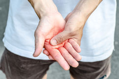 Man holding his hand - suffering pain concept Stock Photo