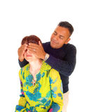 Man holding his hands on wife's eye's. Stock Photo