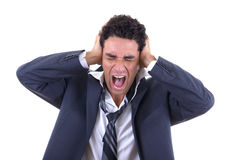 Man holding his head and screaming Stock Images