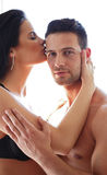 Man holding his kissing girlfriend Stock Images